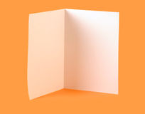 Blank brochure. White blank brochure on orange background Royalty Free Stock Photo
