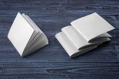 Blank brochures. On dark wooden background Royalty Free Stock Image