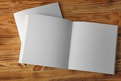 Blank brochures. On wooden background Royalty Free Stock Photo