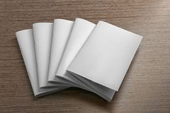 Blank brochures. On wooden background Stock Image