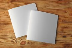 Blank brochures. On wooden background Stock Photos