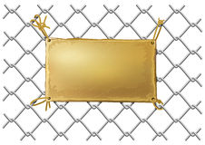 Blank bronze metal plate on a wire net Royalty Free Stock Images