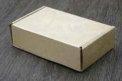Blank brown box mockup. On wood background Royalty Free Stock Photos