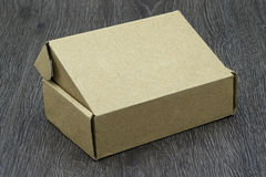 Blank brown box mockup. On wood background Royalty Free Stock Image