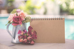 Blank brown card with paper rose flower in metal pot Royalty Free Stock Photos