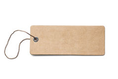 Blank brown cardboard price tag or label with thread isolated. On white royalty free stock photo