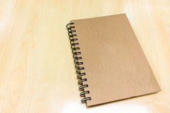 Blank Brown Cover Book on Wooden Table at Corner used as Template Stock Images