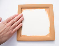 Blank brown frame with hand Royalty Free Stock Photo