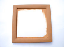Blank brown frame at the wall Stock Photos