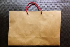 Blank brown paper carrier bag with handles for shopping stock image