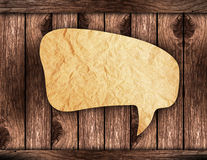 Blank Brown paper Speech on wood background Royalty Free Stock Photo
