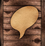 Blank Brown paper Speech on wood background. With Save path on paper for Change background Royalty Free Illustration