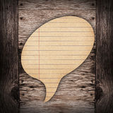 Blank Brown paper Speech on wood background Royalty Free Stock Photography