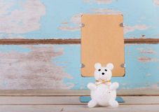 Blank brown paper stand and cute bear for text on grunge blue wo Royalty Free Stock Images