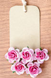Blank brown paper tag and rose. Royalty Free Stock Image