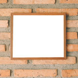 Blank brown picture frame on brick wall Royalty Free Stock Images