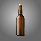Blank brown realistic beer bottle  on grey Stock Photography
