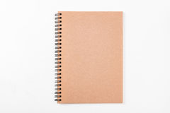 Blank brown spiral paper notebook isolated on white background. Stock Image