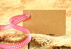 Blank brown tag with a fresh rustic ribbon Stock Photos