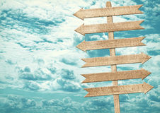 Blank brown wooden signpost against blue sky. Royalty Free Stock Photo