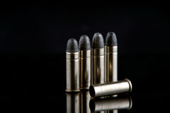 Blank bullet lays on ground Stock Photography