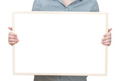 Blank bulletin board in female hand Royalty Free Stock Photography