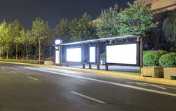 Blank bus stop advertising billboard in the city at night Stock Photography