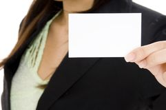 Blank Business Card. A young businesswoman holds up a blank business card Royalty Free Stock Image