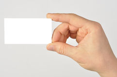 Blank Business Card. Hand holding blank business card isolated on grey background Royalty Free Stock Images
