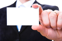 Blank business card. A studio shot of a businessman holding out a blank business card. Room for text, or your own message Stock Images