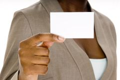 Blank Business Card. A woman holds up a blank business card Stock Image