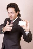 Blank business card. Businessman in a suit holds a blank business card stock photo
