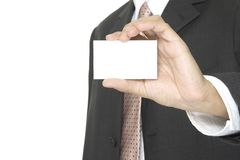 Blank Business Card. A businessman holds up a blank business card Royalty Free Stock Photo