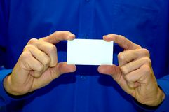 Blank Business Card Against Blue Shirt Royalty Free Stock Image