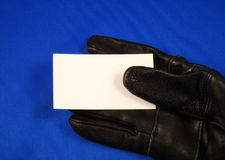 Blank business card on a black glove Royalty Free Stock Images