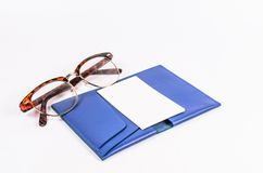 Blank business card on blue leather pocket with glasses Royalty Free Stock Photo