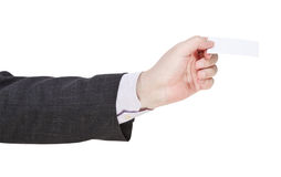 Blank business card in businessman hand Stock Photography
