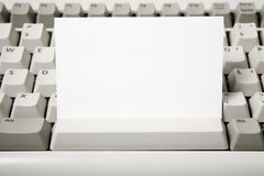 Blank business card and computer keyboard Stock Image