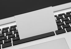 Blank Business card on computer keyboard Stock Photo