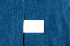Blank business card with copy space in a pocket of blue jean Stock Photos