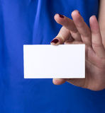 Blank business card. Girl holding blank business card Royalty Free Stock Photos