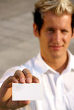 Blank business card in a hand Stock Image