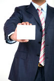 Blank business card in a hand. Businessman showing his business card.You can just add your text there Stock Images