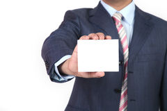 Blank business card in a hand. Businessman showing his business card.You can just add your text there Stock Image