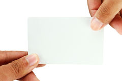 Blank business card on hand. Blank business card on white background Royalty Free Stock Photography