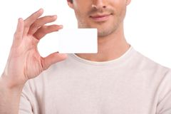 Blank business card in a hand. Happy man holding a business card Royalty Free Stock Photos