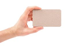 Blank business card in hand isolated on white Stock Photo