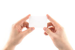 Blank Business Card in a Hand. Male hands holding a blank card Stock Photo