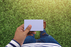 Blank business card on hand for mock up, Top view, present by ca Royalty Free Stock Image