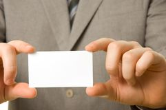 Blank business card in hands stock photo